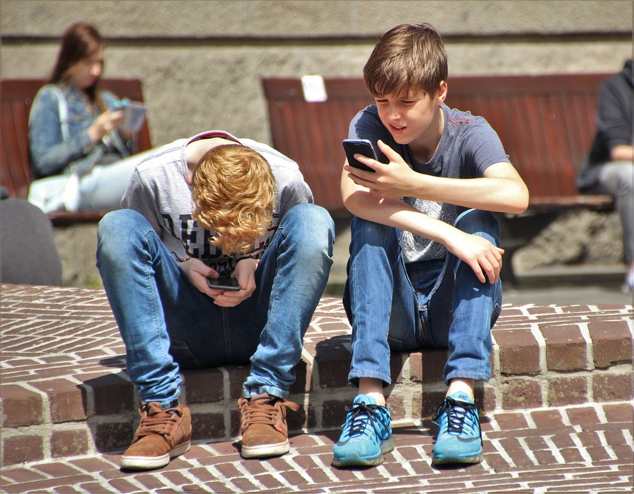 boys playing phone